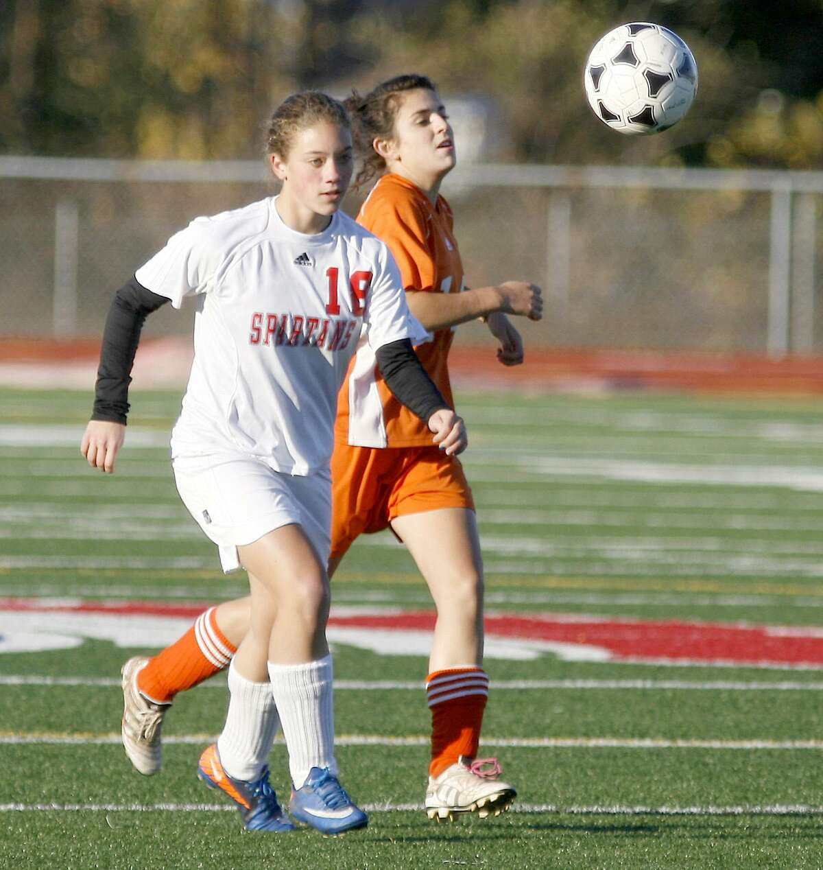 Dispatch Staff Photo by JOHN HAEGER twitter.com/oneidaphoto New Hartford's Alysa Keady (18) and Oneida's Nicole DelPino (14) chase down the loose ball in the first half of the Sec III quarterfinal match in New Hartford on Tuesday, Oct. 25, 2011.