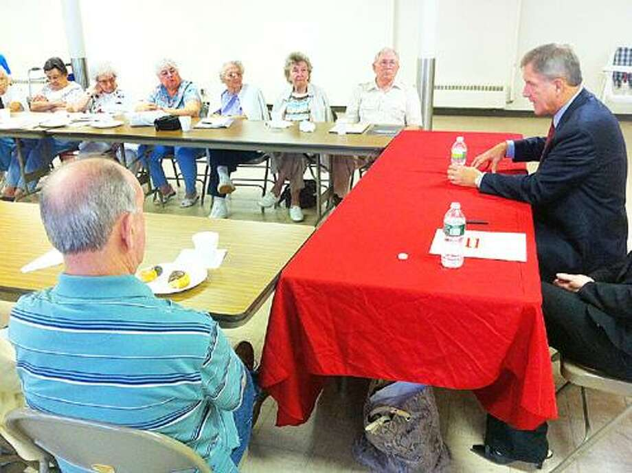 Photo by JOHN HAEGER U.S. Rep. Bill Owens, D-23, meets with seniors in Oneida Wednesday, June 29, 2011.