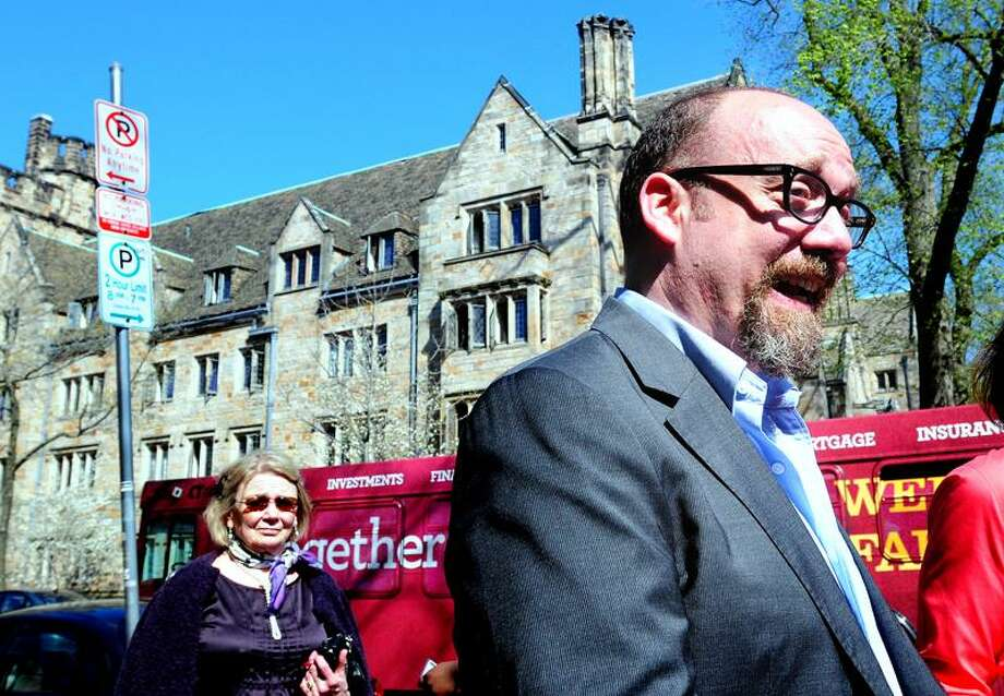Actor Paul Giamatti walks down York Street to Yale's University Theatre in New Haven Tuesday. Arnold Gold/Register