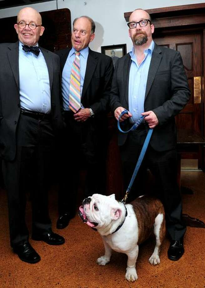 Left to right, Douglas Rae, Chairman of the Board of Governors of Mory's, Robert Blanchard, Mory's Council member, and actor Paul Giamatti are photographed Tuesday at Mory's in New Haven with the Yale mascot, Handsome Dan. Arnold Gold/Register