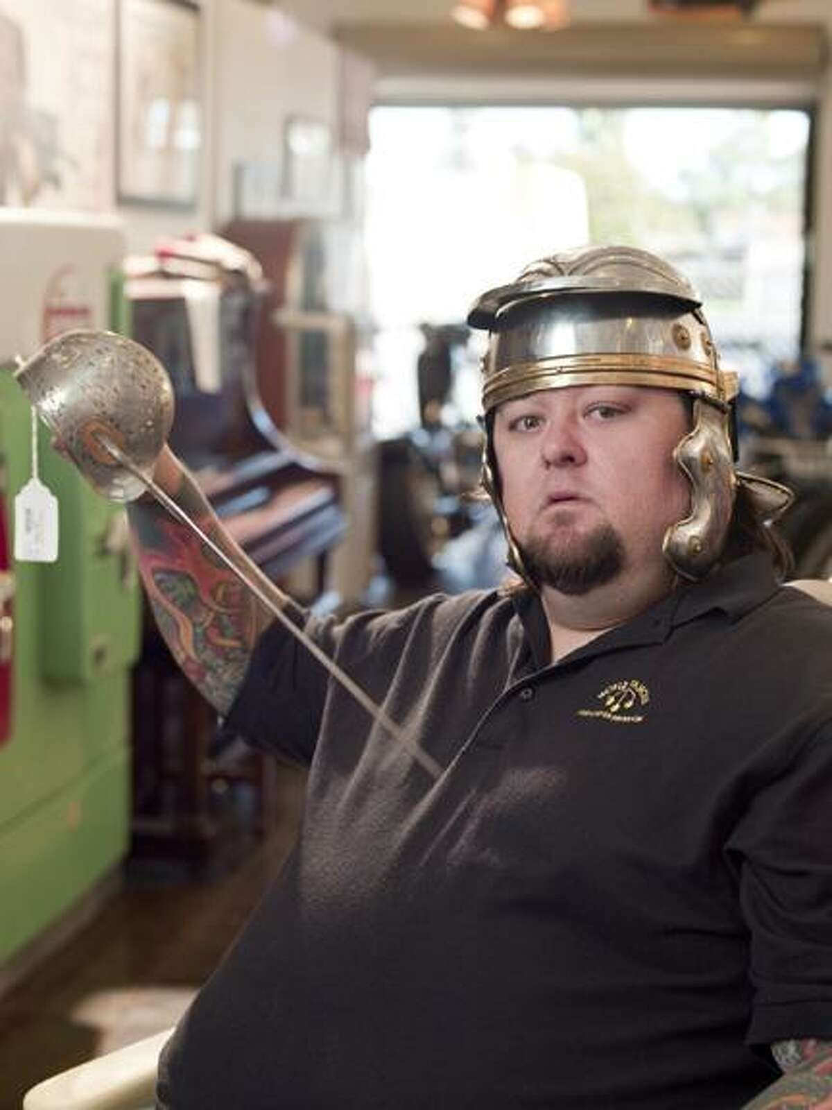 Photo Courtesy The History Channel Chumlee wears a helmet and holds a sword at the Gold and Silver Pawn Shop in Las Vegas, Nev.