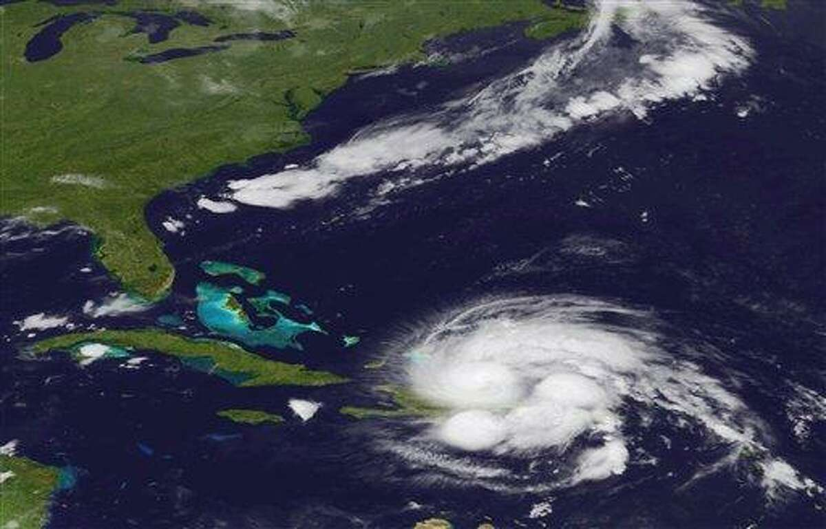 An image released by the NOAA made from the GEOS East satellite shows Hurricane Irene on Aug. 23, 2011 as it passes over Puerto Rico and the Dominican Republic. The storm is on a track that could see it reach the U.S. Southeast as a major storm by the end of the week. (AP Photo/NOAA)