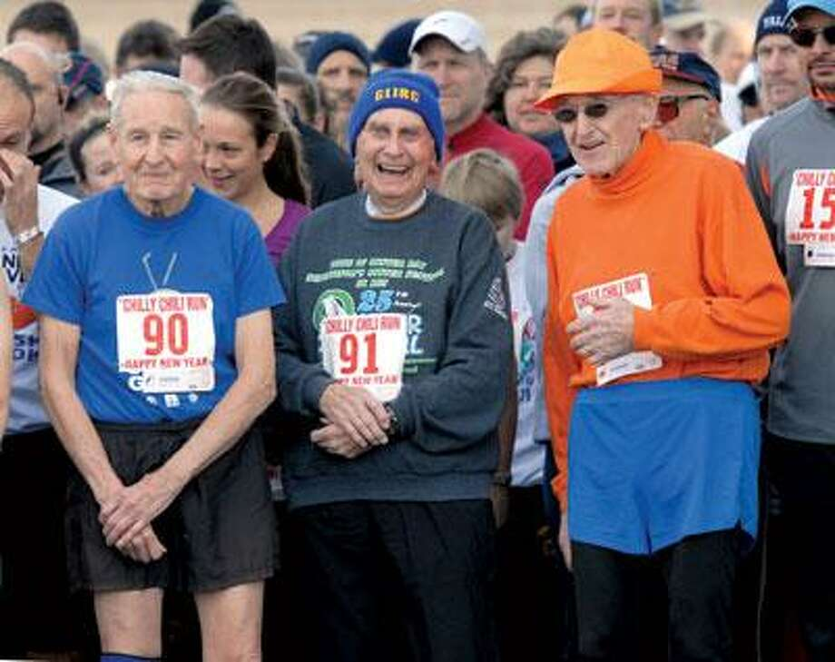 """The Chilly Chili Run 5K road race in Orange featured three nonagenarian runners: From left, Bill Tribou, 90, of Granby, Bill Benson, 91, of Valley Stream, N.Y., and Dr. George """"Doc"""" Whitney, 92, formerly of Orange and now of Brattleboro, Vt. Tribou ran it in 37 minutes, 31 seconds; Whitney ran it in 47:15 and Benson ran it in 68:26. According to race organizers, it was the first time more than one person age 90 and older ran in the same race. (Mara Lavitt/Register)"""