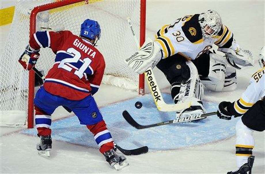 Montreal Canadiens' Brian Gionta (21) scores on Boston Bruins' goaltender Tim Thomas during second period Game 6 NHL Stanley Cup playoff hockey action in Montreal, Tuesday, April 26, 2011. (AP Photo/The Canadian Press, Graham Hughes) Photo: AP / Graham Hughes