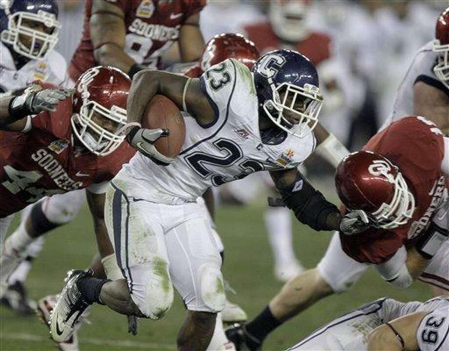 Connecticut Huskies running back Jordan Todman (23) gains yards against Oklahoma during the third quarter of the Fiesta Bowl NCAA college football game Saturday, Jan. 1, 2011, in Glendale, Ariz. (AP Photo/Paul Connors) Photo: AP / FR5880 AP