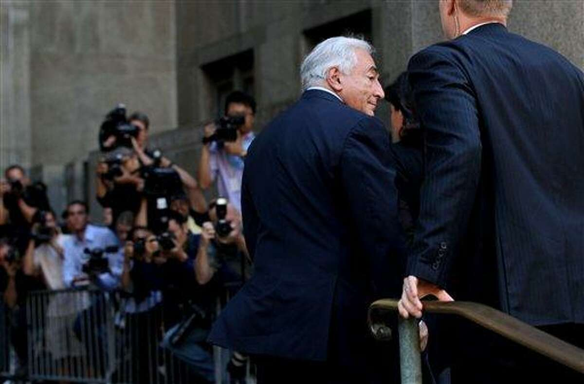 Dominique Strauss-Kahn enters the Criminal Courts Building in New York on Tuesday, Aug. 23, 2011. The case against Strauss-Kahn, who accused by Hotel housekeeper Nafissatou Diallo of sexual assault, was expected to be dismissed. (AP Photo/Craig Ruttle)