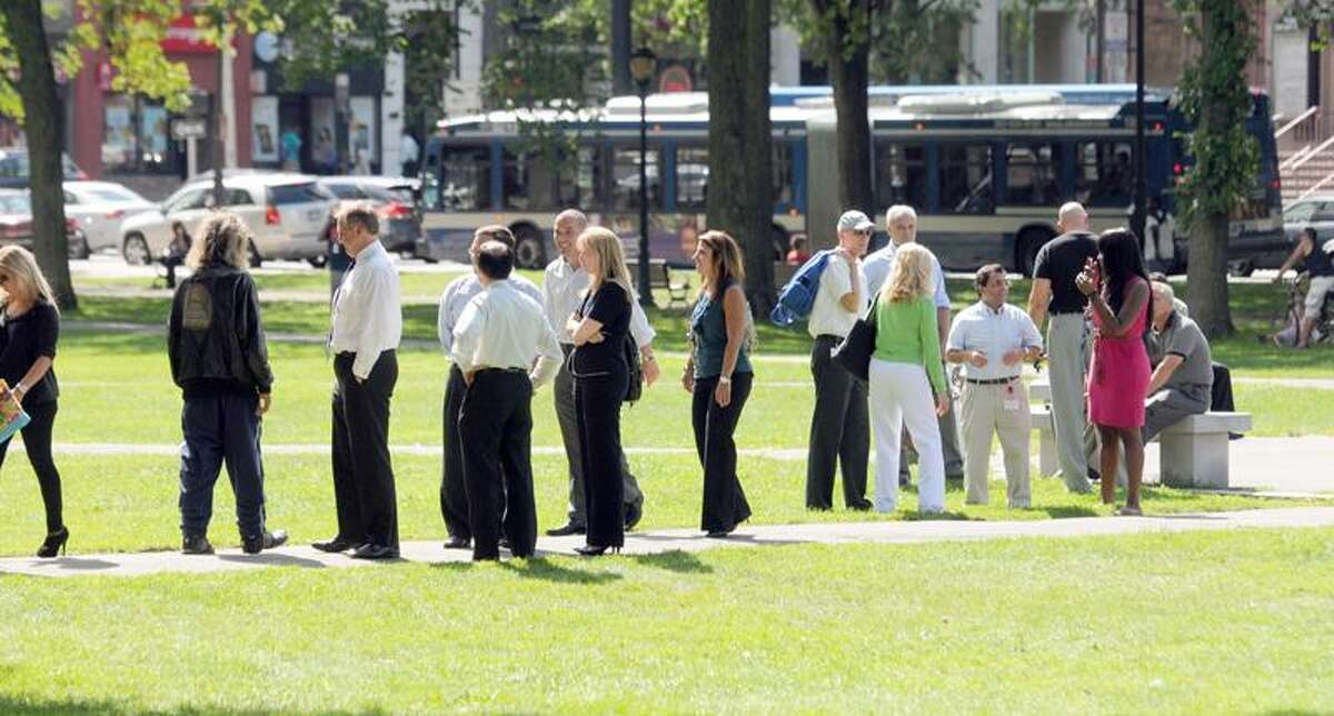 Earthquake tremors felt in New Haven from a Virginia quake sent downtown employees onto the Green. Photo by Mara Lavitt/New Haven Register8/23/11