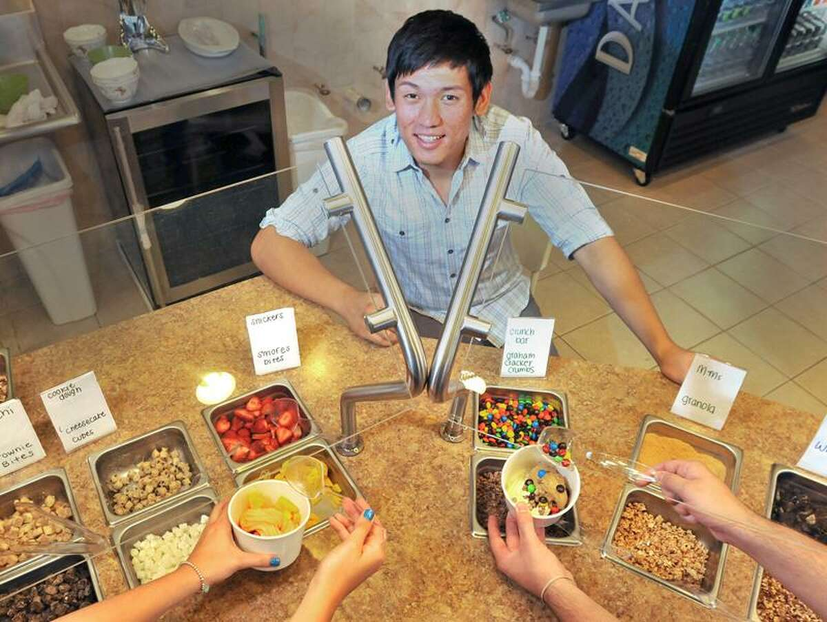 "Jimin ""Jason"" Moon, a 21 year-old Amity graduate, owns NuVita Frozen Yogurt & Cafe at 35 Old Tavern Road in Orange. Brad Horrigan/Register"