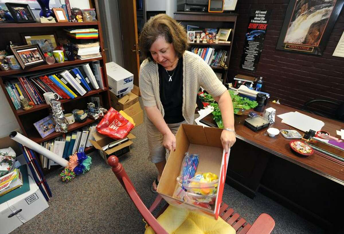 Edith E. Mackrille Elementary School Principal Pat Libero cleans out her office Tuesday afternoon. Libero is retiring after 37 years in the West Haven school system. Photo by Brad Horrigan/Register