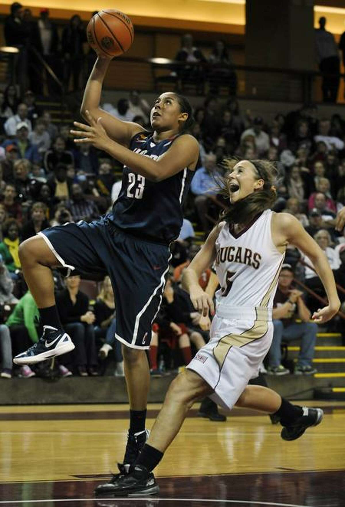 Connecticut's Kaleena Mosqueda-Lewis (23) goes for a layup against College of Charleston's Cathryn Hardy (5) during the first half of an NCAA college basketball game on Wednesday, Dec. 21, 2011, in Charleston, S.C. (AP Photo/Rainier Ehrhardt)