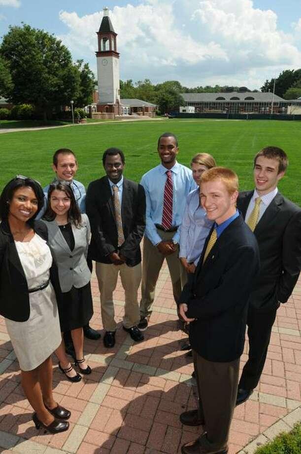 Quinnipiac University students were interns in Hamden and North Haven government. Left to right: LaToya Aitcheson, Vanessa Baez, Matthew Pankey, Jamar Paris, Devon Jerome, Mary Nelligan, Jeremy Stull and Ben Cloutier. Mara Lavitt/Register