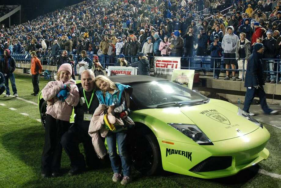 Associated Press David Dopp, 34, of Santaquin, Utah, poses with his daughters Shayla, left, and Olivia, right, after winning a Lamborghini on Nov.12 in Maverik's Sweepstakes at Brigham Young University's LaVell Edwards Stadium in Provo, Utah.