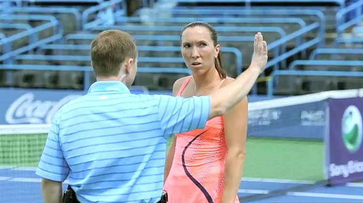 A New Haven Open at Yale offical interrupts Jelena Jankovic's match to inform her she must vacate the premises due to the earthquake Tuesday. Peter Casolino/Register