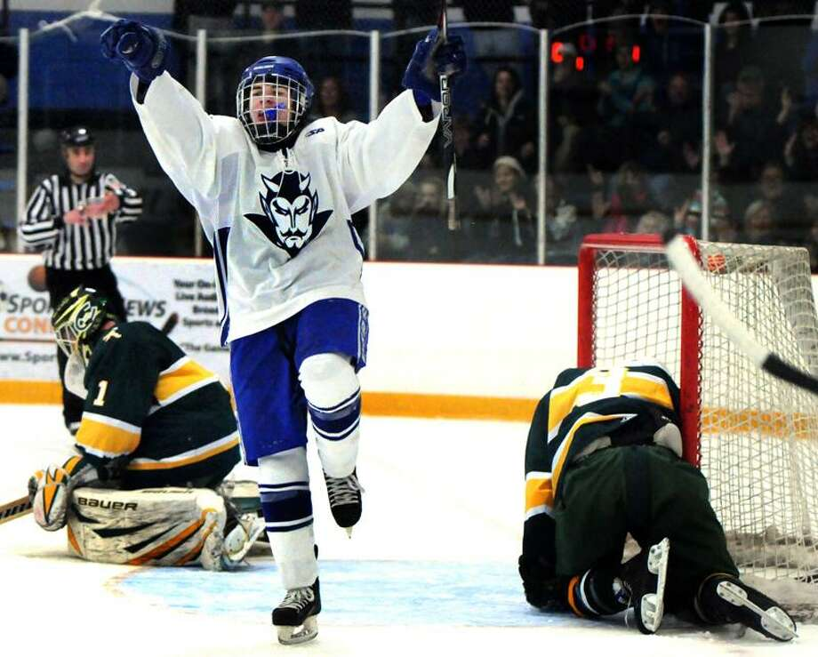 Mike Troiano of West Haven celebrates after scoring a goal against Trinity Catholic. Photo by Peter Hvizdak / New Haven Register