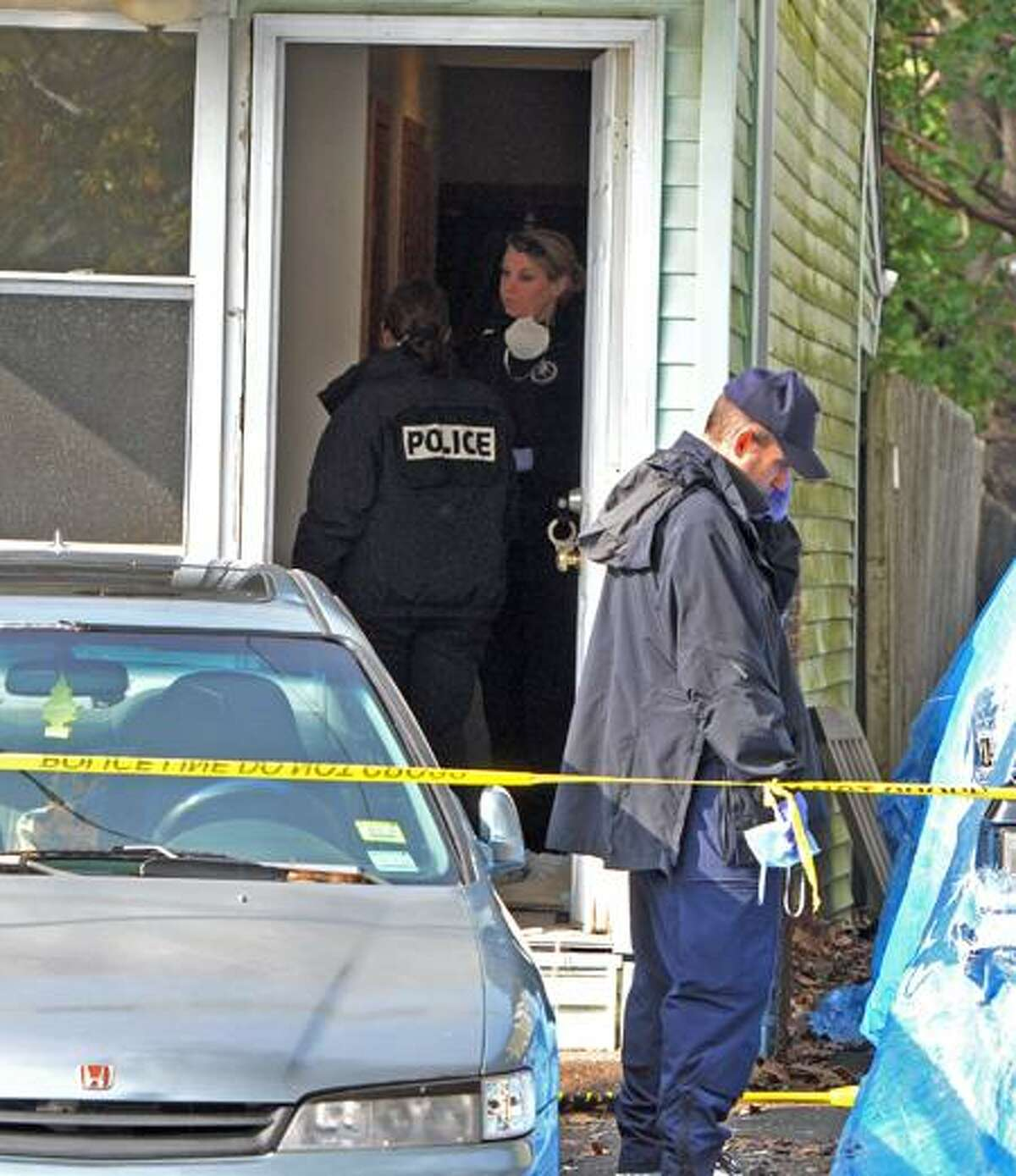 New Haven Police investigate the shooting of Marquell Banks, 13, who was fatally killed by a shotgun blast while in an apartment at 154 Porter St. in New Haven Sunday night. (Peter Hvizdak/Register)