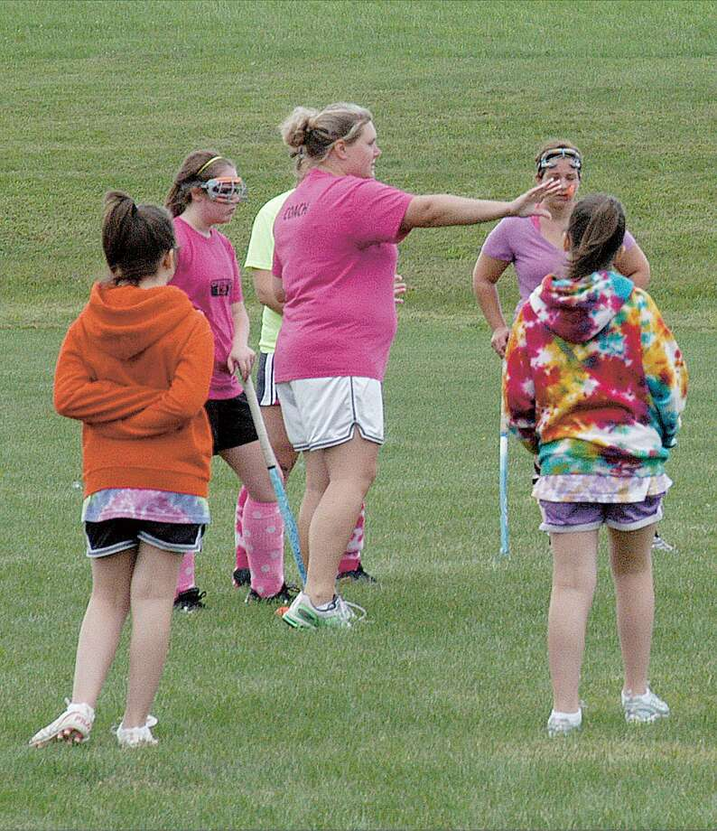 Dispatch Staff Photo by DAVID M. JOHNSONNew Oneida field hockey coach Bonnie Barlow gives instructions on the first day of practice Monday, August 22, 2011 in Oneida. Monday was also the first day of practice for high school soccer, cross country and girls tennis.