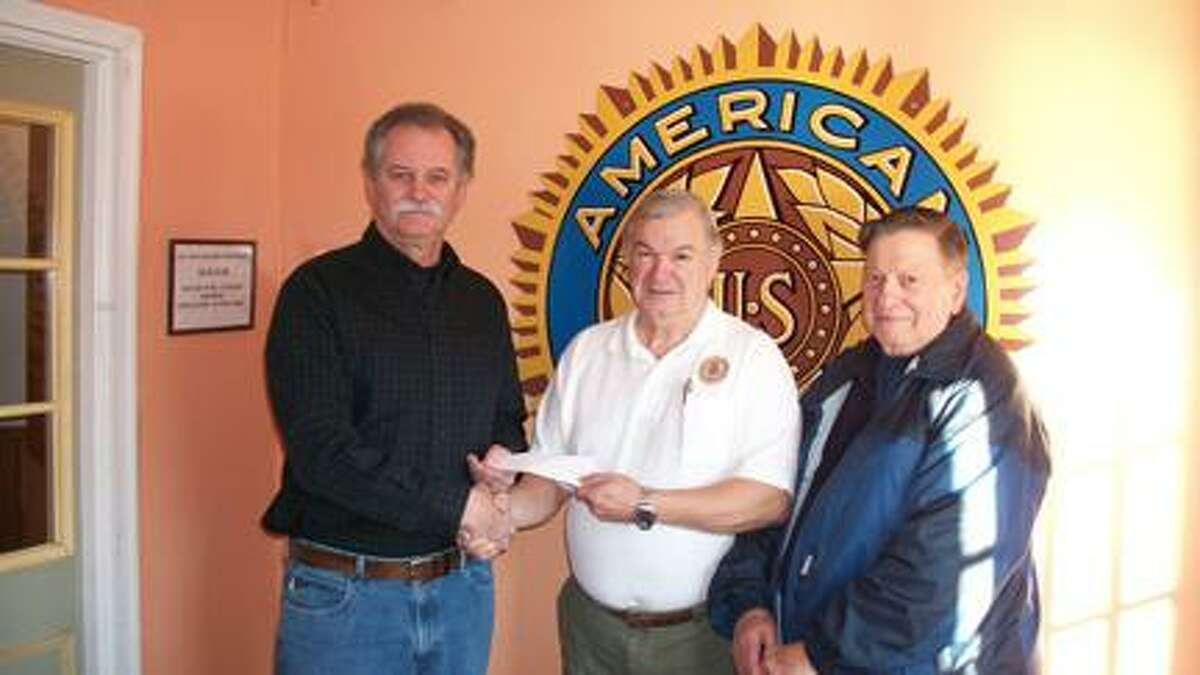 Submitted PhotoAccepting a donation, from left, is board of directors Dave Liddy, Commander John Doiron and Paul Thompson Sr. Thompson is the grandfather of fallen army soldier Spc. Blair D. Thompson of Rome.