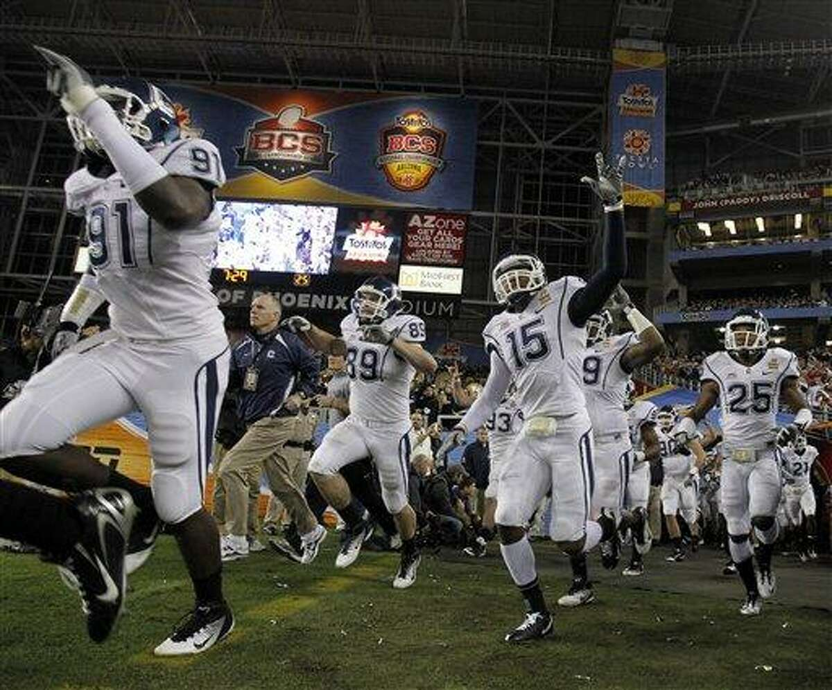 Connecticut takes the field prior to the Fiesta Bowl NCAA college football game against Oklahoma Saturday, Jan. 1, 2011, in Glendale, Ariz. (AP Photo/Ross D. Franklin)