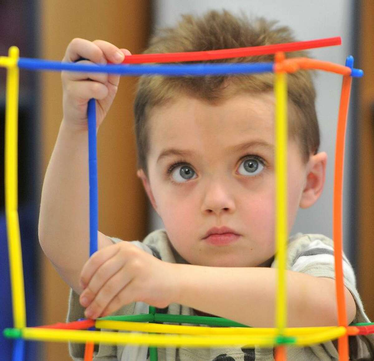 North Branford--Kindergartner Pete Podoloff concentrates on his building Monday morning at the new Family Resource Center building at Jerome Harrison Elementary School in North Branford. Monday was the first day the students were in the new building. Photo by Brad Horrigan/New Haven Register-04.25.11.