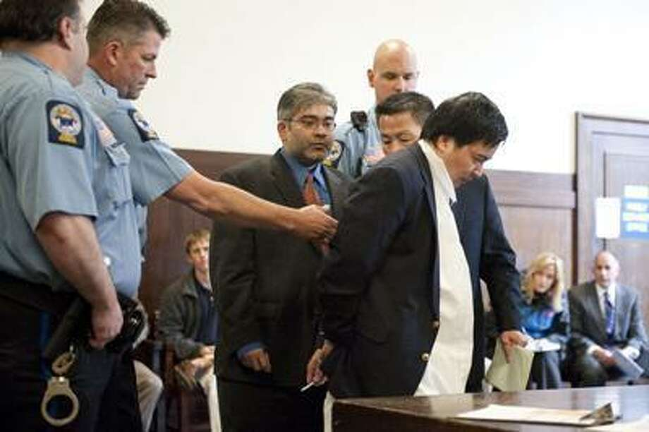 Lishan Wang a Chinese National from Beijing is arraigned in New Haven, Superior Court in New Haven Conn. Tuesday April 27, 2010 in connection to the murder of Vajinder Toor. (Pool Photo/Douglas Healey). / copyright Douglas Healey