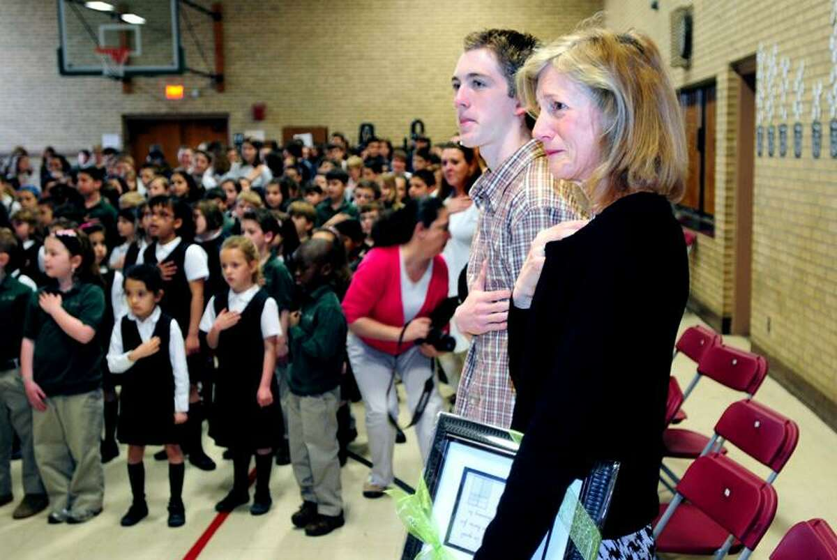 Laura Sklaver, right, mother of the late Army Capt. Benjamin Sklaver, gets teary-eyed during an assembly at St. Rita School in Hamden Monday. Students announced at the assembly that $5,500 was raised for the ClearWater Initiative, which was started by Capt. Sklaver. To her left is Ted Kennedy, 17, who raised money at Hamden High School for the cause. (Arnold Gold/Register)