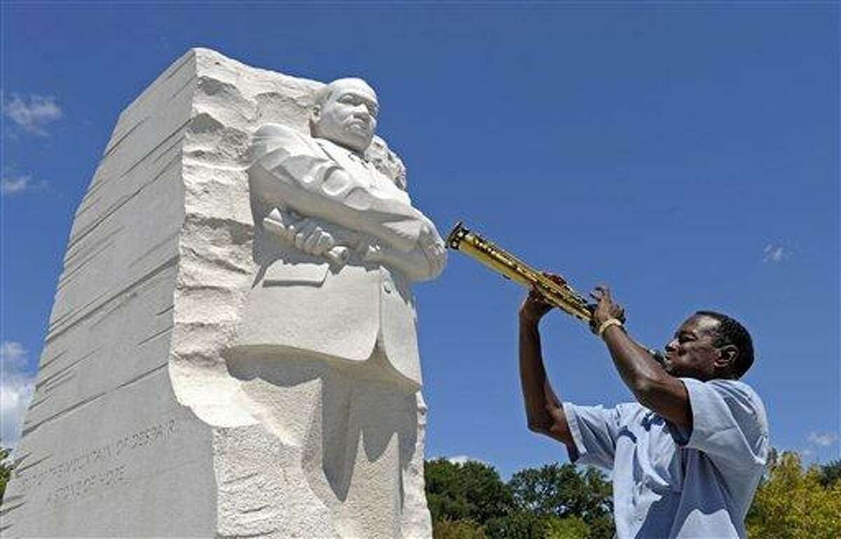 """James """"Plunky"""" Branch plays his soprano saxophone near the new Martin Luther King, Jr., Memorial in Washington, Monday, Aug. 22, 2011. (AP Photo/Susan Walsh)"""