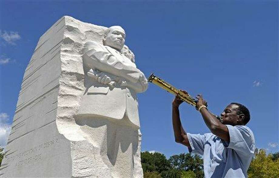 "James ""Plunky"" Branch plays his soprano saxophone near the new Martin Luther King, Jr., Memorial in Washington, Monday, Aug. 22, 2011. (AP Photo/Susan Walsh) Photo: AP / AP"