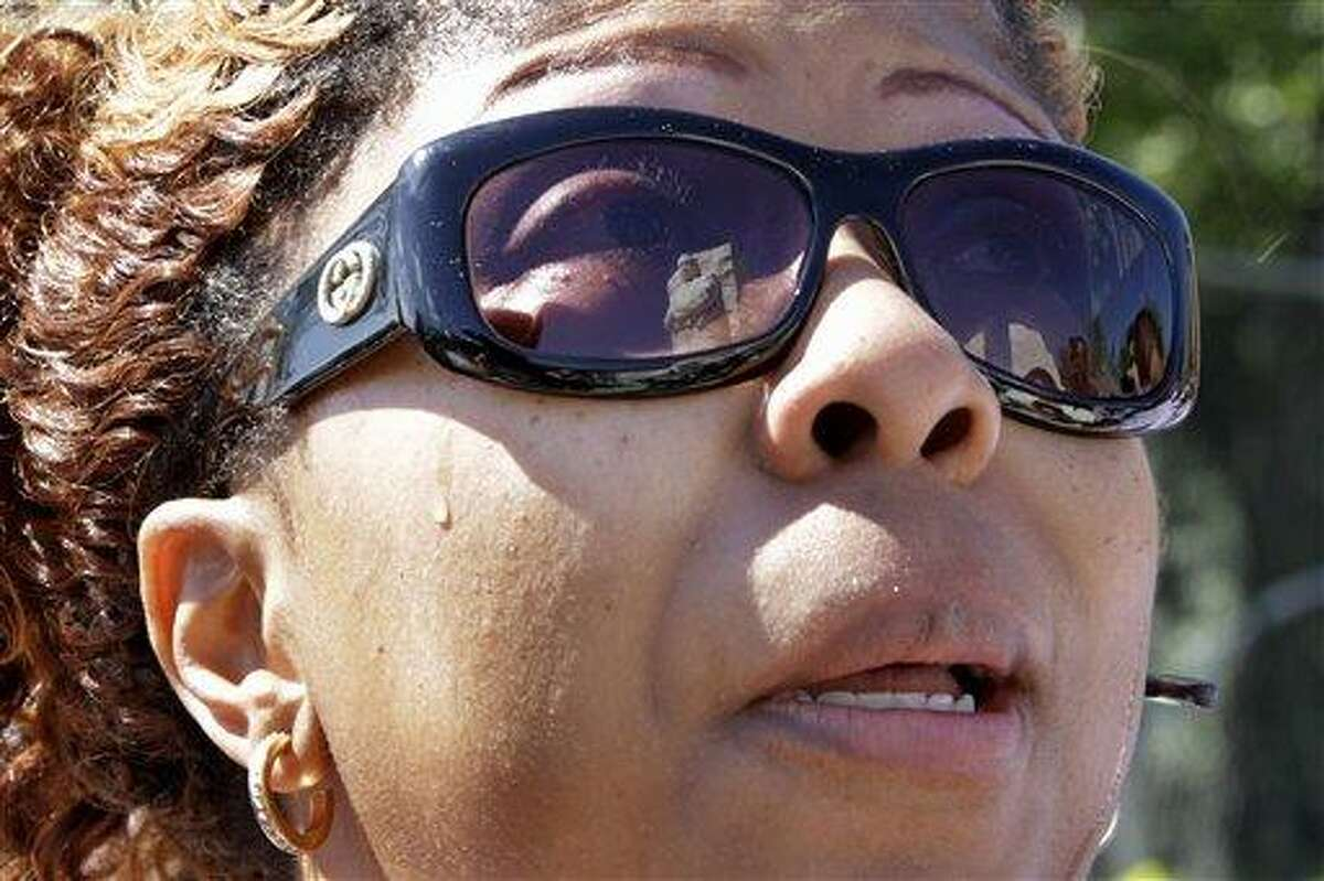 With the statue of Dr. Martin Luther King, Jr., reflected in her sunglasses, Kwanzaa Nivens, of Washington, gets emotional as she looks at the Martin Luther King, Jr. Memorial for the first time in Washington, on Monday, Aug. 22, 2011. The memorial will be dedicated on Sunday. (AP Photo/Jacquelyn Martin)