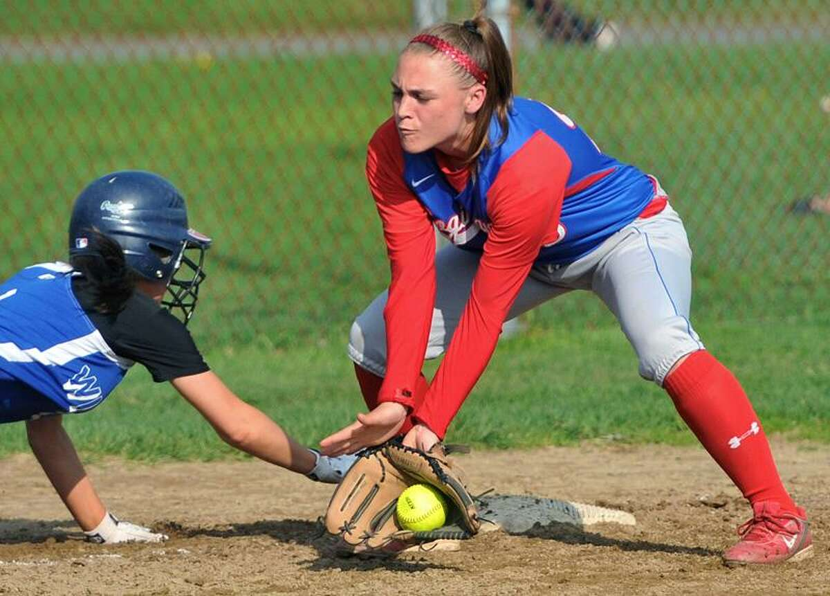 Old Lyme baserunner Kelsey Riggs dives back into third base as Coginchaug third baseman Liz Sanseveio tries to make the play on a throw back from the catcher during Monday's game in Durham. Photo by Brad Horrigan/New Haven Register.