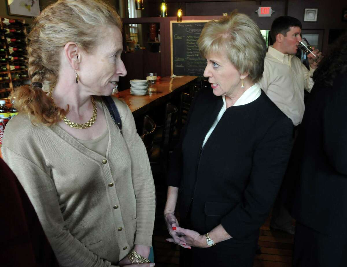 """Real estate businesswoman Barbara Pearce, left, speaks Monday with U.S. Senate candidate Linda McMahon at a """"listening to women in business"""" roundtable at Cave a Vine in New Haven. Mara Lavitt/New Haven Register"""