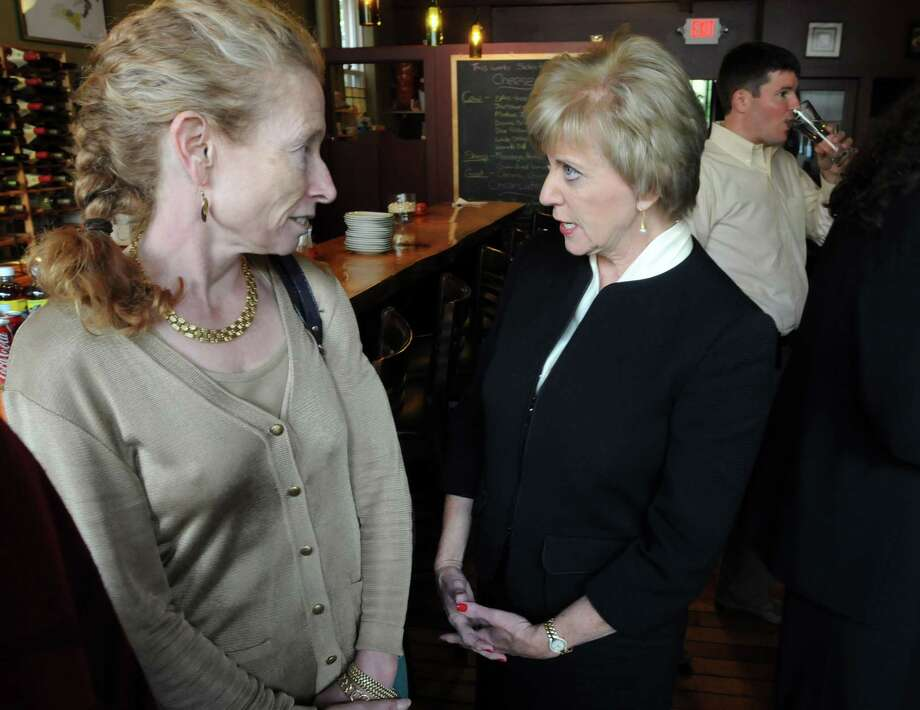 "Real estate businesswoman Barbara Pearce, left, speaks Monday with U.S. Senate candidate Linda McMahon at a ""listening to women in business"" roundtable at Cave a Vine in New Haven. Mara Lavitt/New Haven Register"