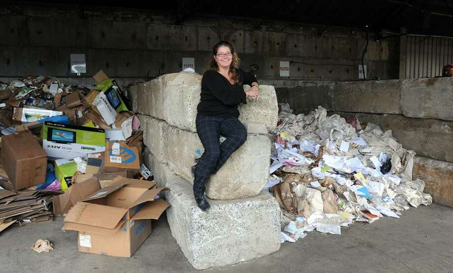 Milford- Darlene Chapdelaine, owner of Recycling Inc., hopes to help those in need through recycling. Peter Casolino/New Haven Register.   10/24/11