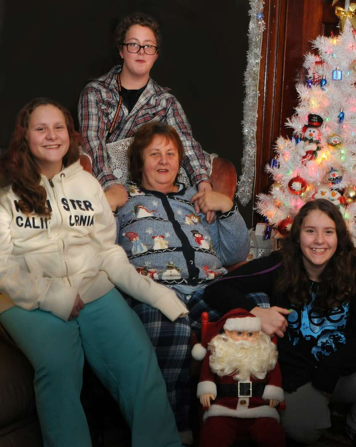 Melanie Stengel/Register Single mother Joyce Mueller's family of Shelton needs a holiday gift as she recuperates from breast cancer surgeries. She is unable to work while she also caring for her special needs triplets, Nicole, Tommy, and Jessie, 13.