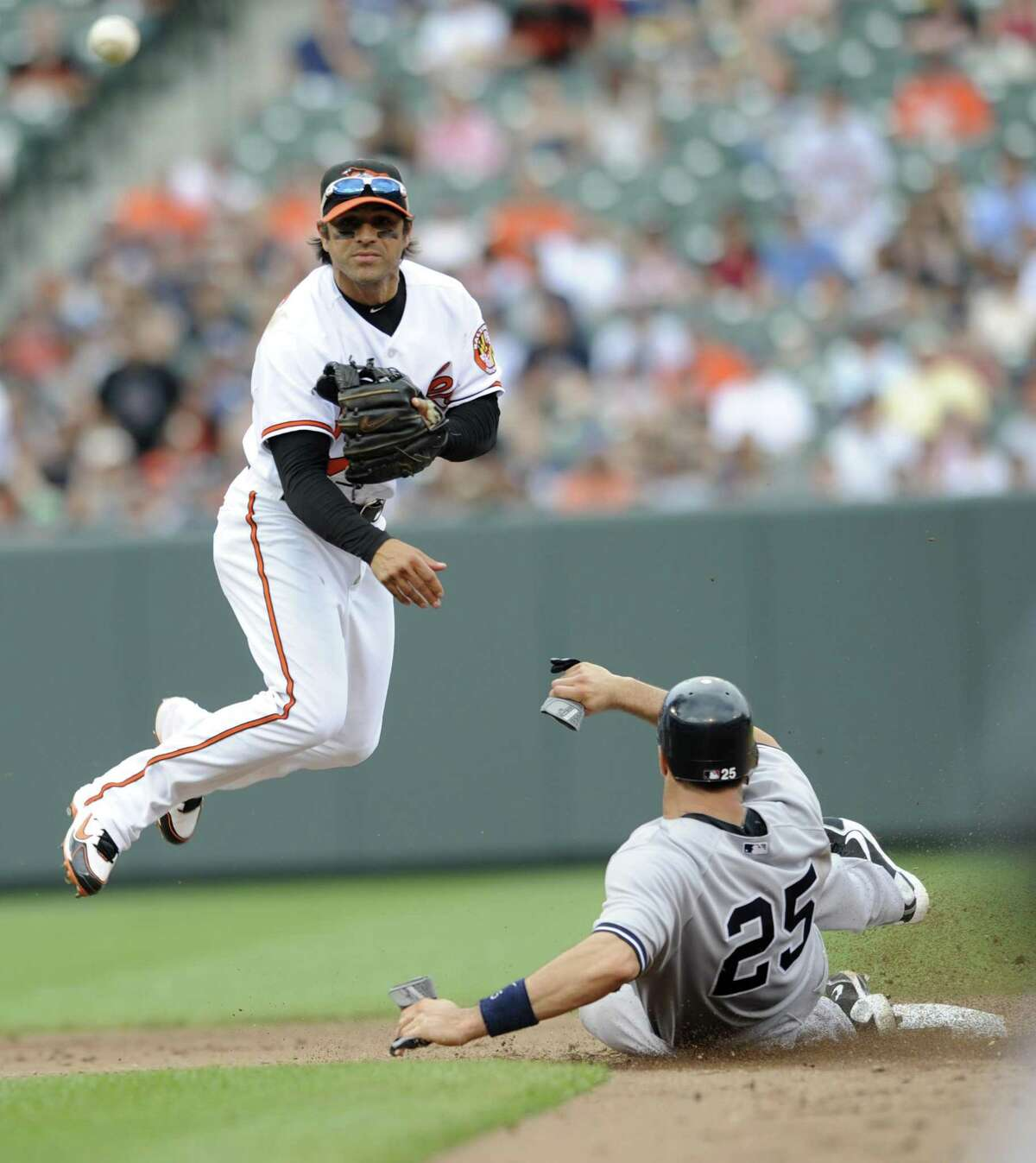 Baltimore Orioles second baseman Brian Roberts throws to first as New York Yankees' Mark Teixeira is out on a ground ball hit by Alex Rodriguez during the fifth inning of a baseball game, Sunday, April 24, 2011, in Baltimore. Rodriguez was safe at first. (AP Photo/Gail Burton)