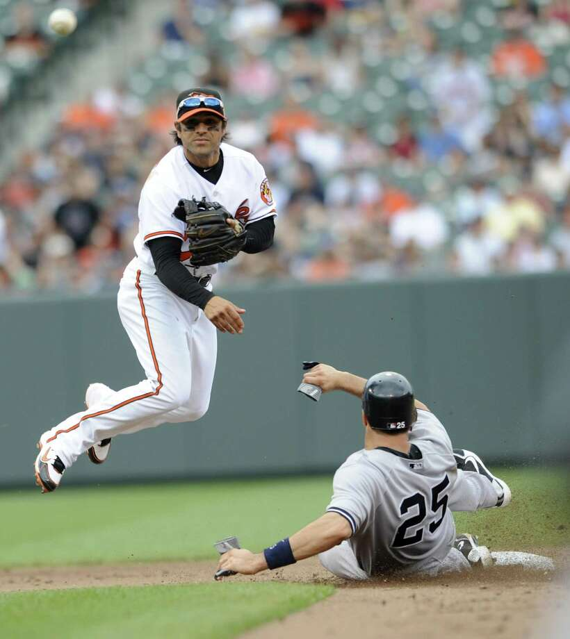 Baltimore Orioles second baseman Brian Roberts throws to first as New York Yankees' Mark Teixeira is out on a ground ball hit by Alex Rodriguez during the fifth inning of a baseball game, Sunday, April 24, 2011, in Baltimore. Rodriguez was safe at first. (AP Photo/Gail Burton) Photo: AP / FR4095 AP
