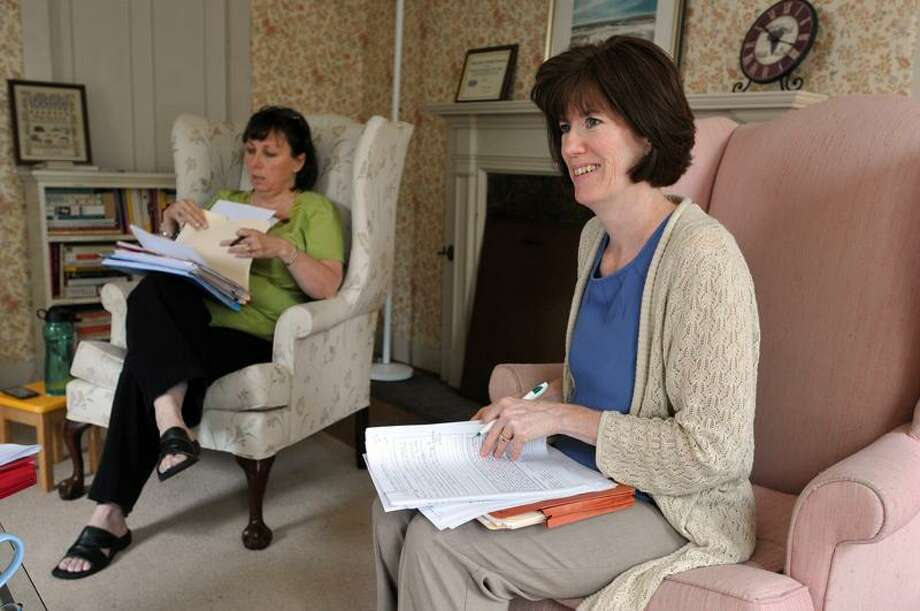 Peggy Britt, right, the new executive director of the Women and Family Life Center, conducts a meeting with a community group. At left is Lori Lodge, operations director at the center. Peter Casolino/Register  Cas110620   6/10/20