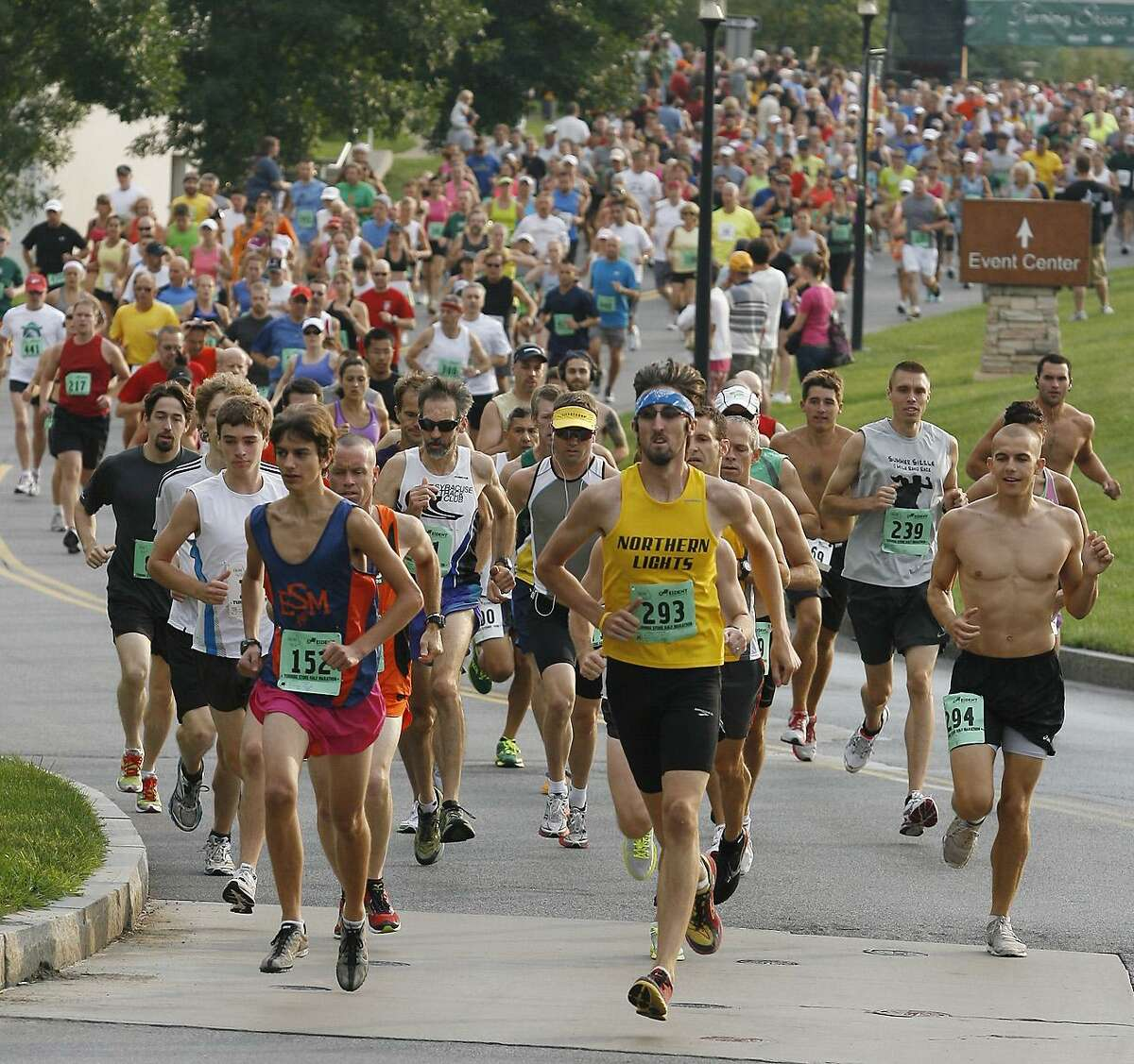 Dispatch Staff Photo by JOHN HAEGER10K and Half marathon runners leave the start line on Sunday Aug. 21, 2011 in Verona.