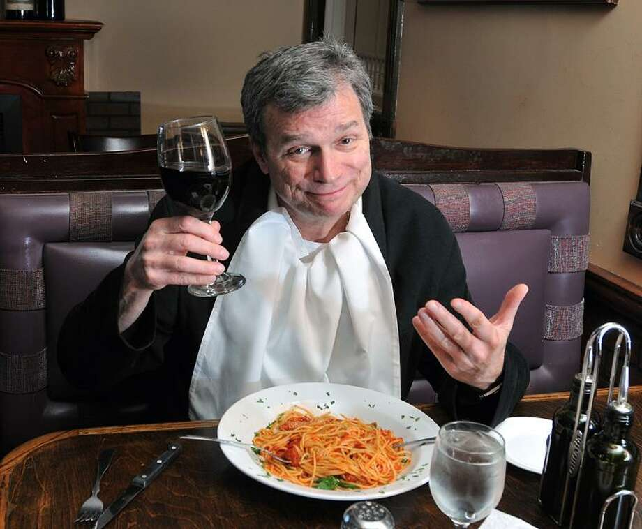 "John Procaccino plays the lead character in Long Wharf's production of ""Aldo."" He is shown at Brazi's Restaurant. (Peter Casolino/New Haven Register)"