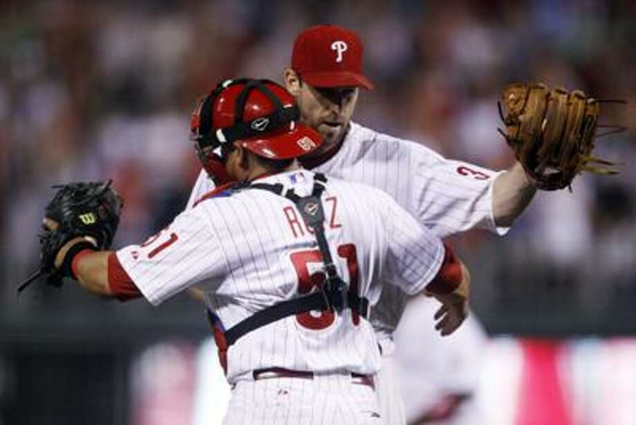 Philadelphia Phillies starting pitcher Cliff Lee, right, and catcher Carlos Ruiz celebrate after winning an interleague baseball game against the Boston Red Sox, Tuesday, June 28, 2011, in Philadelphia. Philadelphia won 5-0. (AP Photo/Matt Slocum) Photo: AP / AP