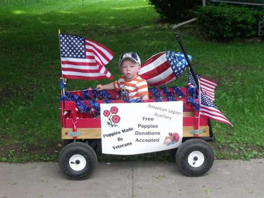 Submitted PhotoAlec France, the youngest Sons of the Munnsville American Legion Post 54 member, volunteered with his Mom to help distribute Poppies during the annual Memorial Day Parade.