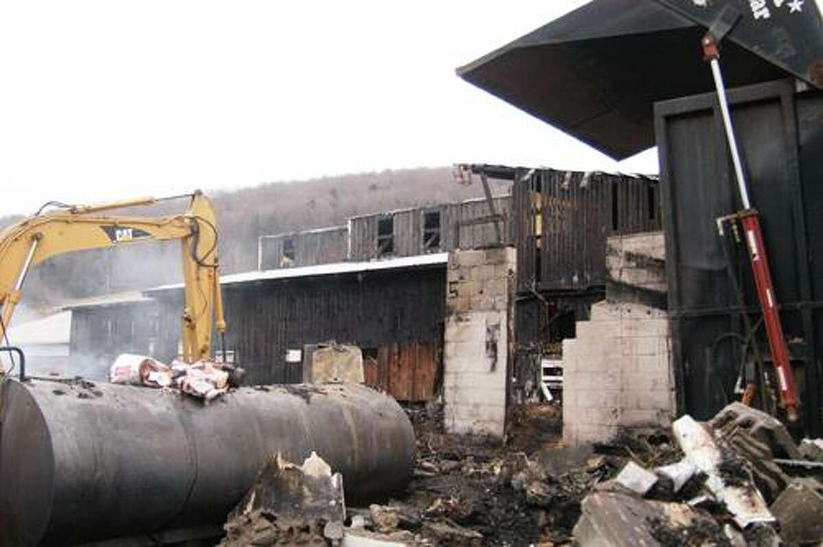 Dispatch Staff Photo by MATT POWERS A barn fire on Sunday, Dec. 18, 2011 killed a dozen young cattle at Woodstead Farm in DeRuyter.