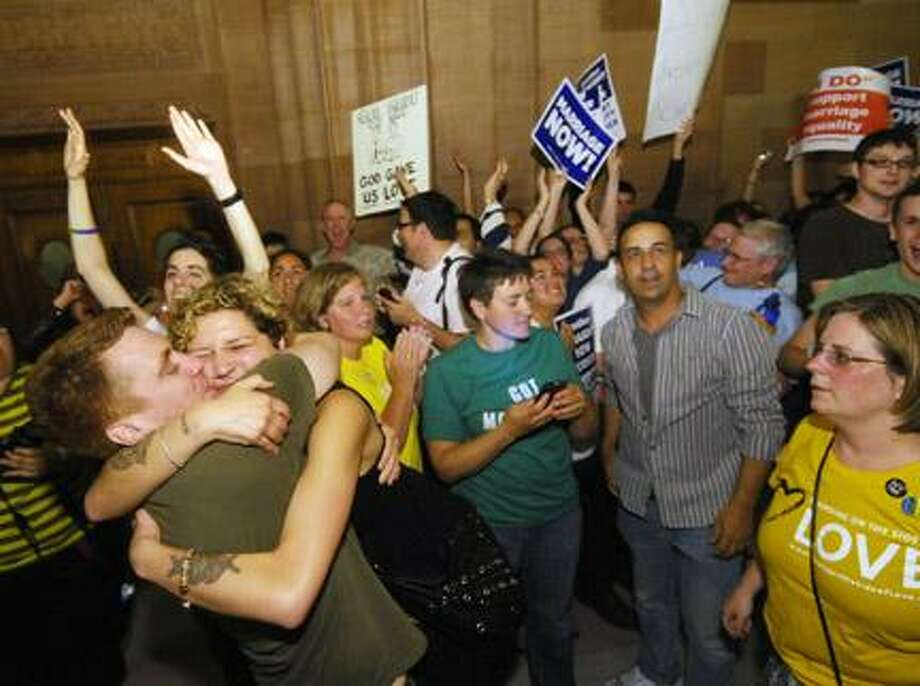 AP Photo by Hans PenninkSupporters of same sex marriage celebrate after Senate members voted and approved same-sex marriage at the Capitol in Albany, N.Y., Friday, June 24, 2011. New York lawmakers narrowly voted to legalize same-sex marriage Friday, handing activists a breakthrough victory in the state where the gay rights movement was born.  New York will become the sixth state where gay couples can wed and the biggest by far. Photo: ASSOCIATED PRESS / AP2011