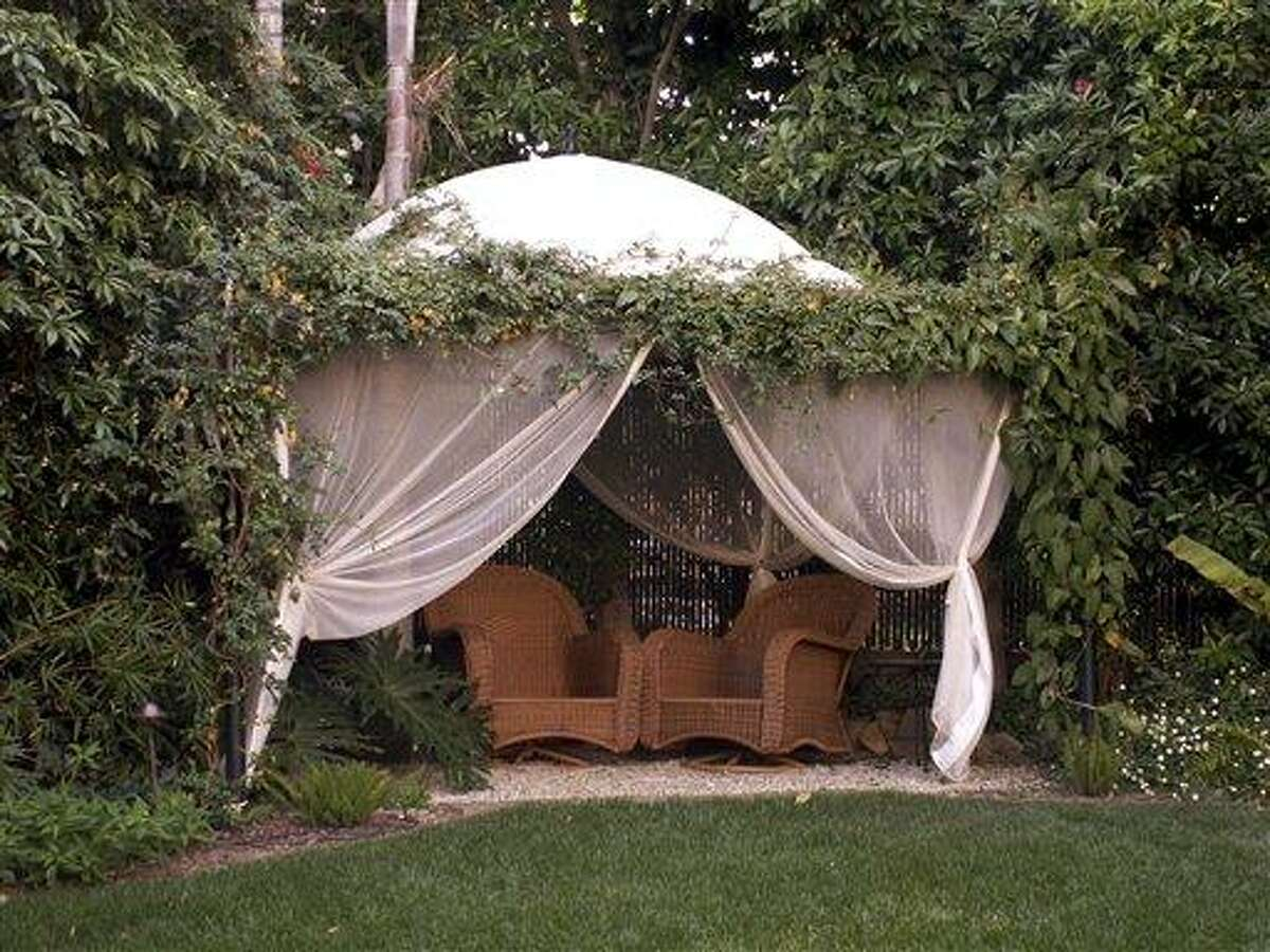 This undated photo courtesy of Holly Lepere Photography shows an outdoor space designed by Grace Designs. There are many creative fencing and landscape options that can help create a zone of privacy in your yard. (AP Photo/Holly Lepere Photography)