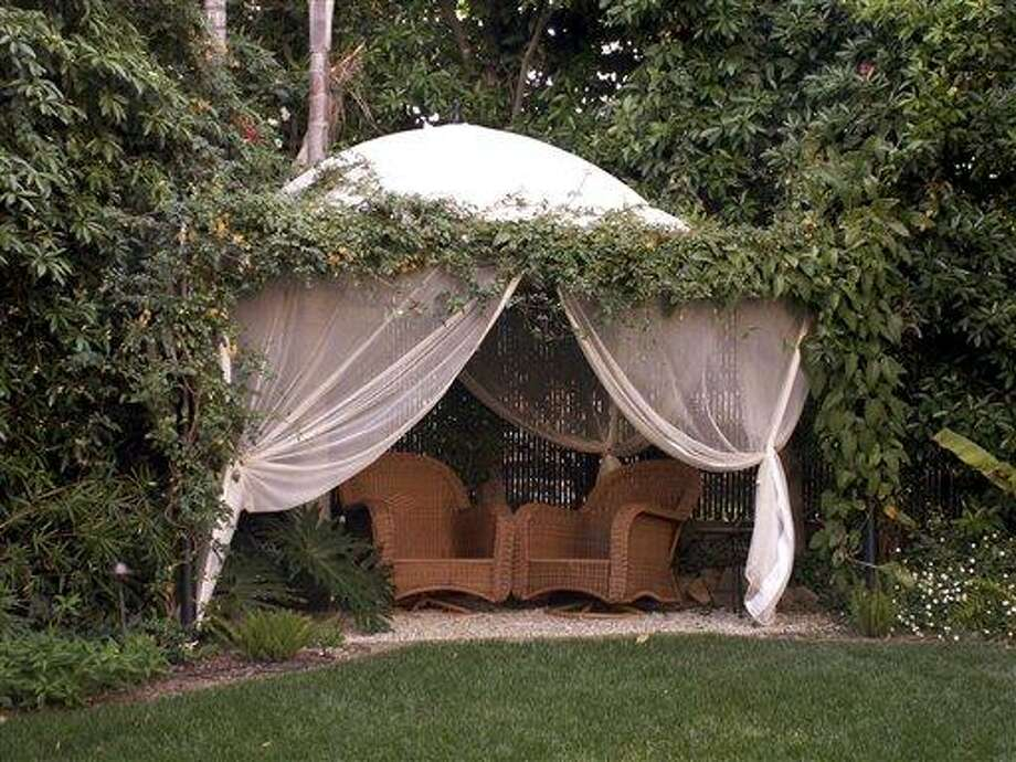 This undated photo courtesy of Holly Lepere Photography shows an outdoor space designed by Grace Designs.  There are many creative fencing and landscape options that can help create a zone of privacy in your yard.   (AP Photo/Holly Lepere Photography) Photo: AP / Holly Lepere Photography