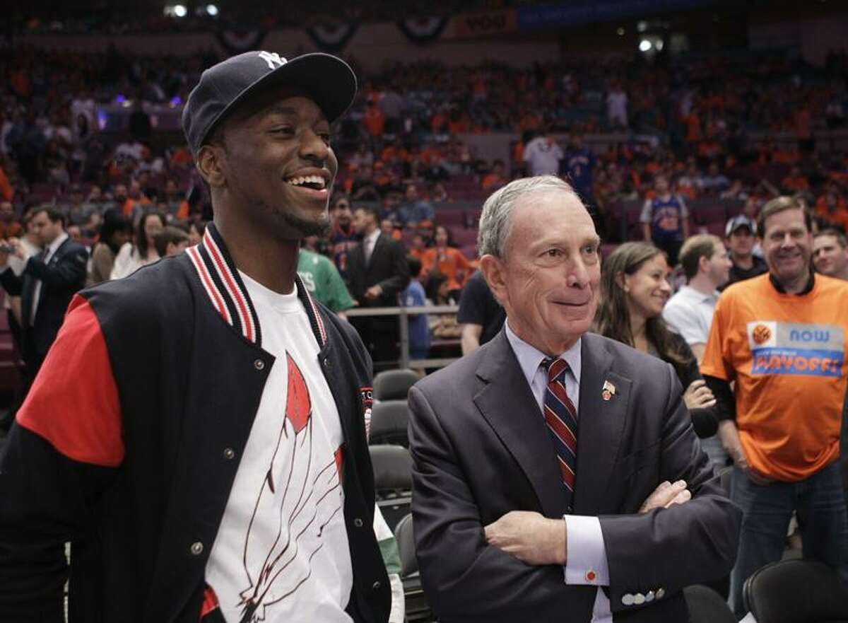 Kemba Walker, left, chats with New York Mayor Michael Bloomberg before Game 4 of the Knicks-Celtics series in New York on Sunday.(AP Photo/Kathy Willens)