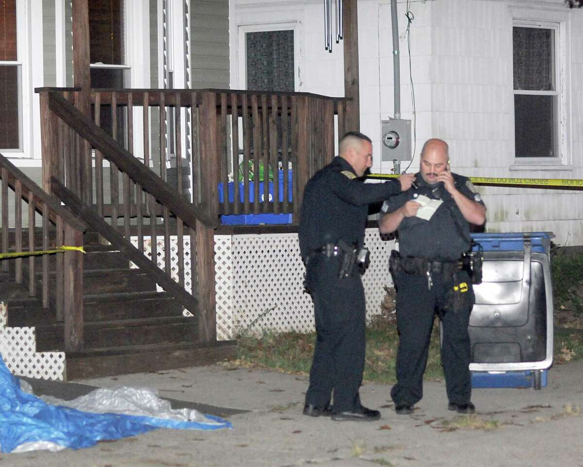 New Haven Police investigate the shooting death Sunday of a 13-year old on Porter Street. Peter Hvizdak / Register