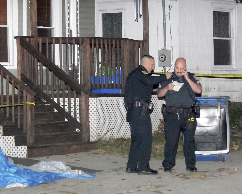 New Haven Police investigate the shooting death Sunday of a 13-year old on Porter Street. Peter Hvizdak / Register / PETER HVIZDAK