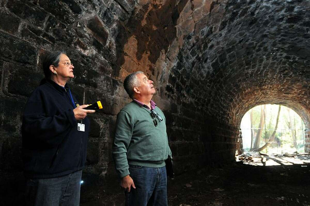 Kayrn Gilvarg, New Haven city planner, and Vincent McDermott, senior vice president of landscape architecture and planning at Milone and MacBroom, look over the tunnel under Temple Street that is part of the new Farmington Canal Line trail expansion through the city. Peter Casolino/New Haven Register.