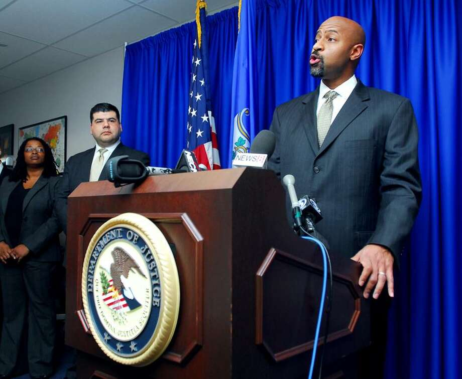 Deputy Assistant Attorney General for the Department of Justice Civil Rights Division Roy Austin (right) announces the results of the investigation into the East Haven Police Department on 12/19/2011.Photo by Arnold Gold/New Haven Register   AG0432F