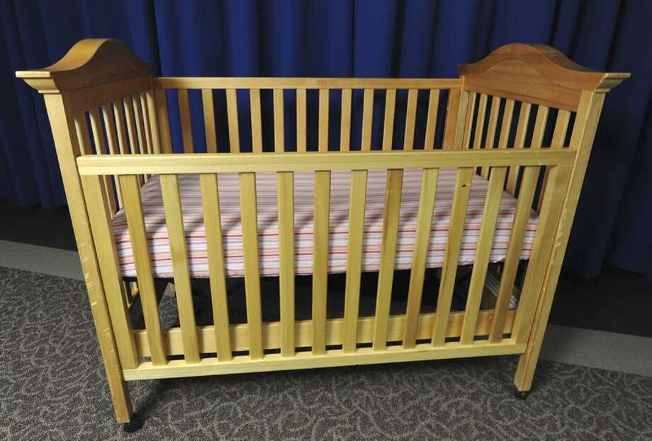 The Fed has banned drop-side cribs and beginning Tuesday, a new generation of cribs, ones that are supposed to be safer, will be the only ones allowed to be sold across the country - in stores, online and even in neighborhood yard sales. (Assocated Press) Photo: AP / Consumer Product Safety Commissi
